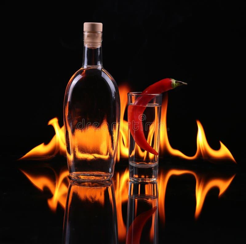 Pile de tequila sur le feu photos stock