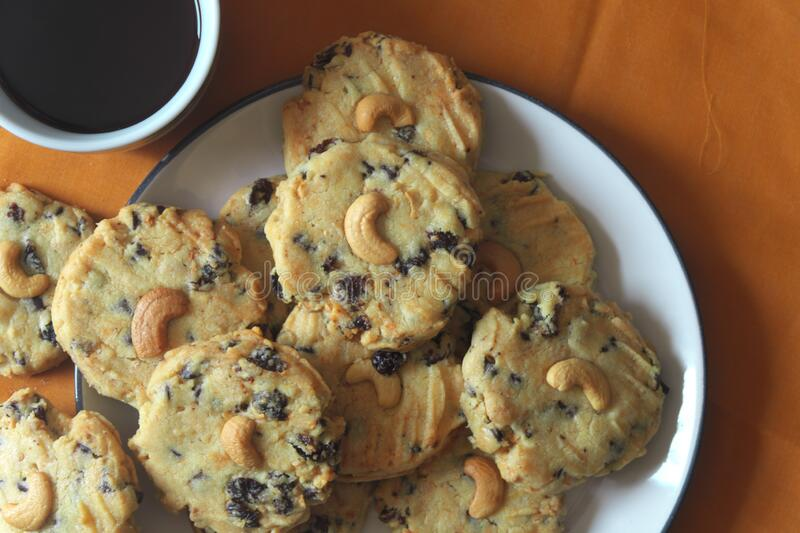 Pile of Delicious Chocolate Chip Cookies on a White Plate with coffee breakfast stock images