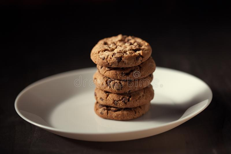 Pile of Delicious Chocolate Chip Cookies on a White Plate royalty free stock photography