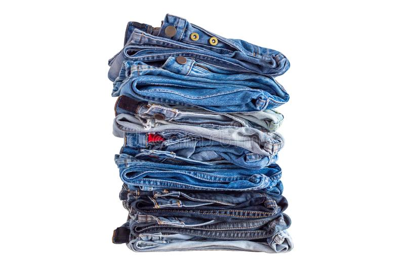 Pile of denim blue jeans stack isolated on white royalty free stock photos