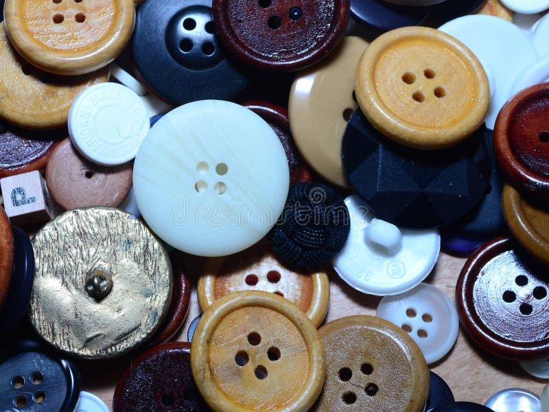 Pile des boutons de couture image stock