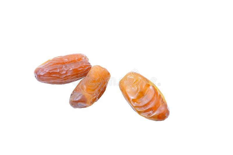 Pile des fruits de datte sèche d'isolement sur le fond blanc photographie stock libre de droits