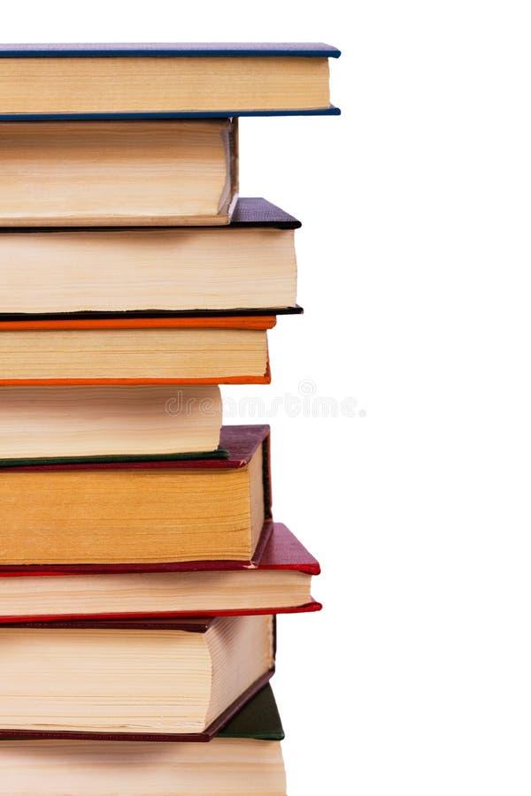 Pile des livres d'isolement photographie stock