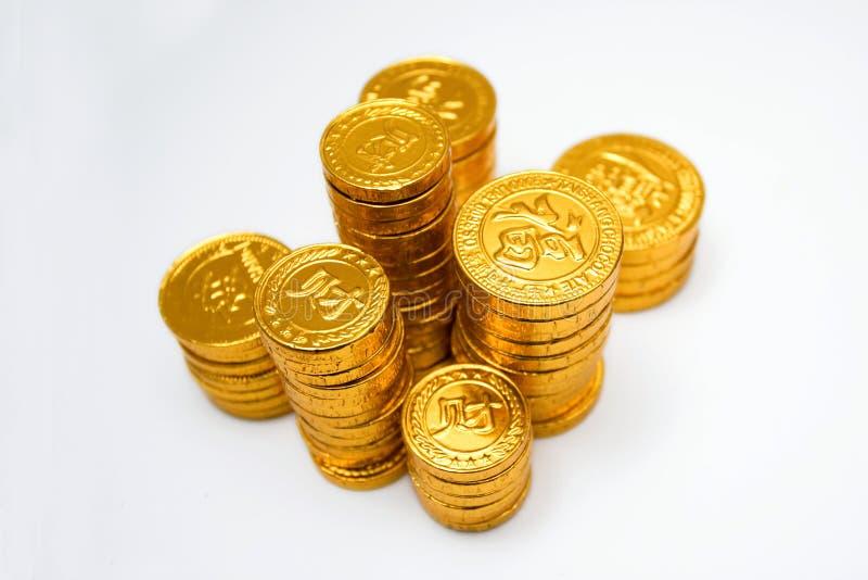 Pile di monete di oro immagini stock