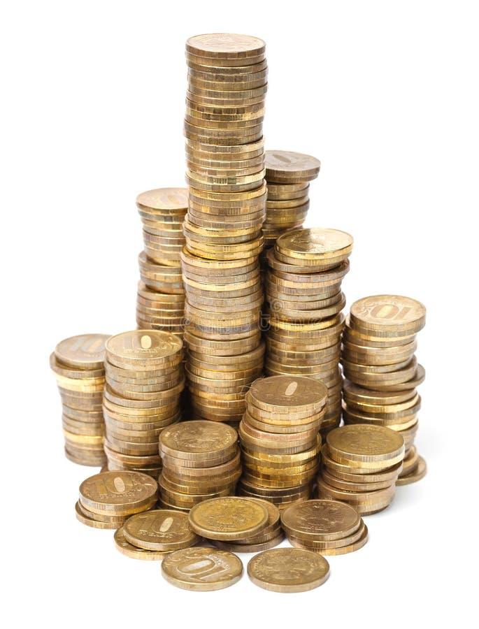 Pile di monete dorate immagine stock