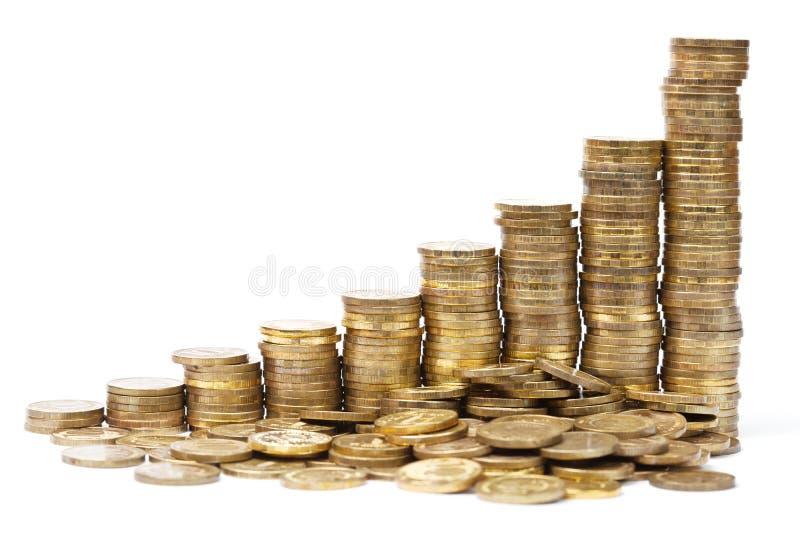 Pile di monete in un grafico di successo fotografia stock