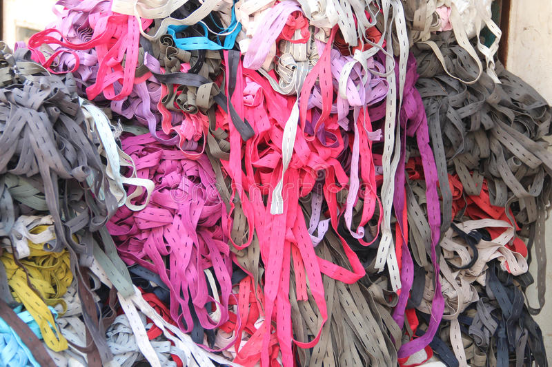 Pile of different color Elastic fabrics. For garments accessories stock photos