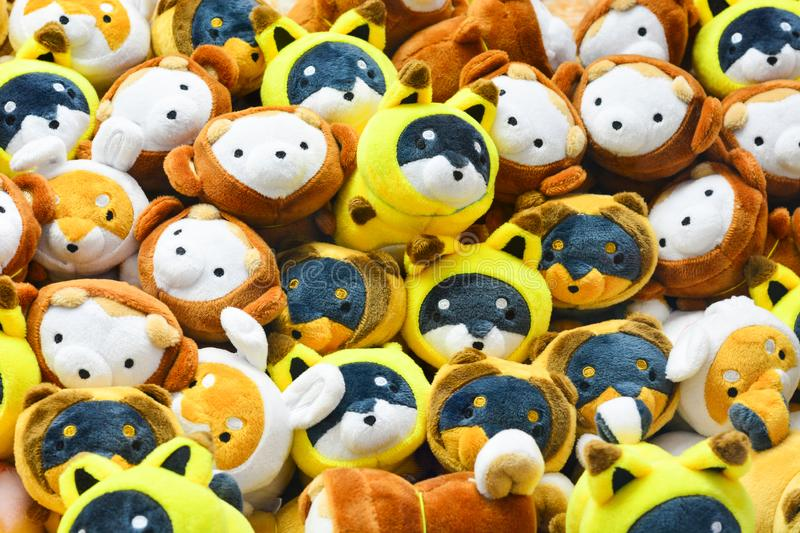 Pile of different color Shiba Inu dog cartoon dolls in claw crane game vending machine at games entertainment center in Tokyo. Japan stock image
