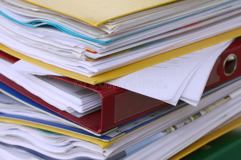 Pile of different file folders or ring binders full with office documents stock image