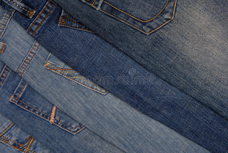 Pile of different jeans, back side stock photography