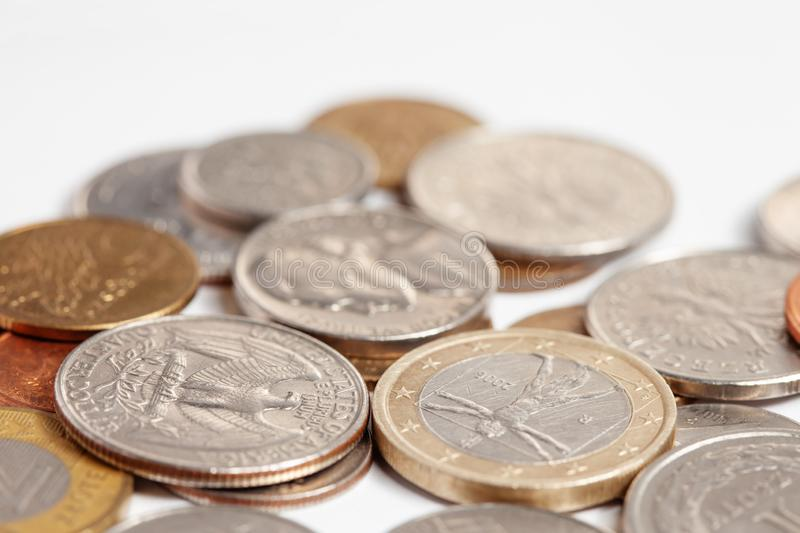 Pile of different metal coins. Dollar and euro opposition stock image