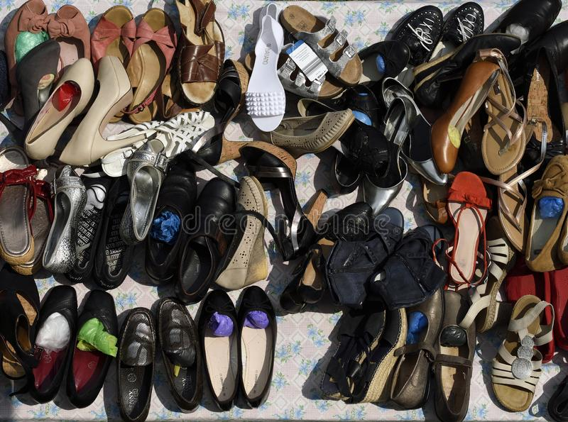 Second hand shoes at street flea market stock image