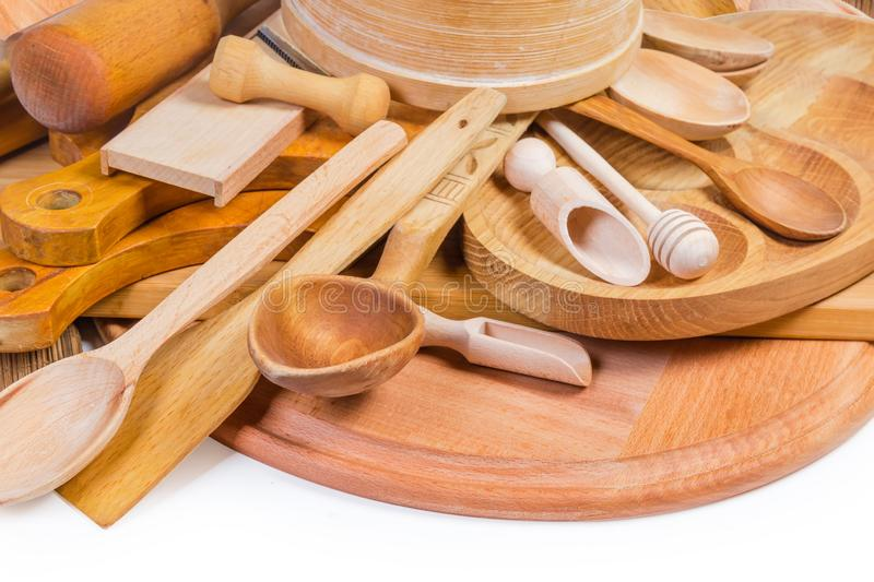 Pile of different wooden kitchen utensils close-up royalty free stock images