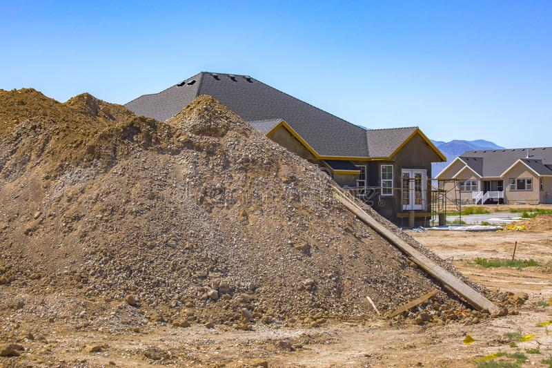 Pile of dirt dug out for home basement. Of house being constructed in Eagle Mountain, Utah stock photos