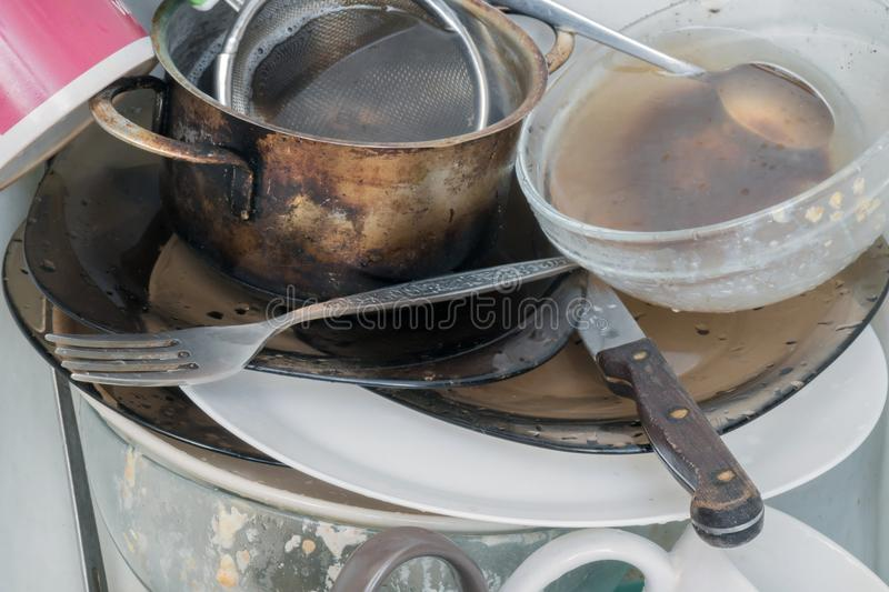 Pile of dirty dishes stock photography