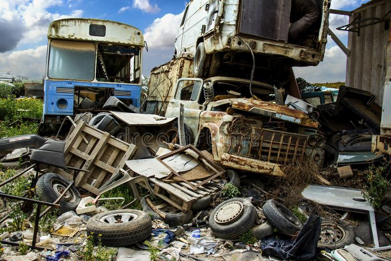 Discarded cars on junkyard stock images