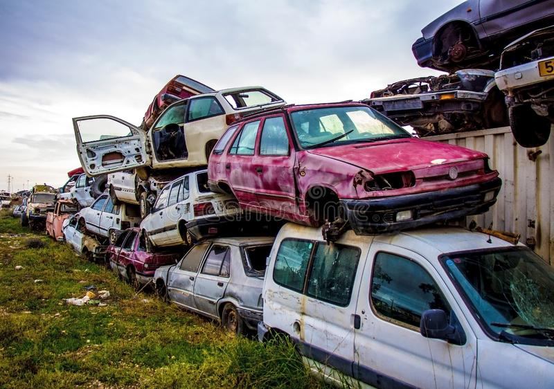 Pile of discarded old cars on junkyard stock photo
