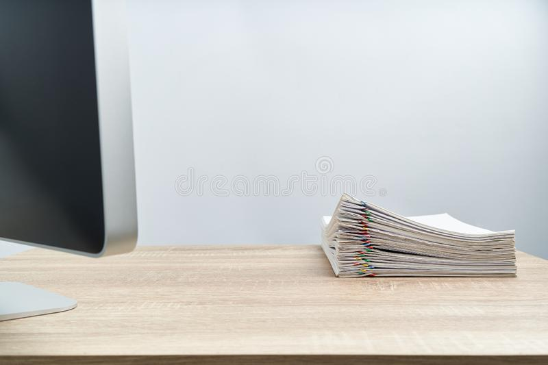 Pile of document report and computer on wooden table royalty free stock photos