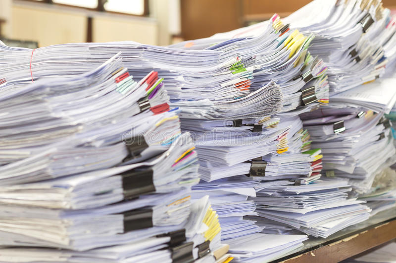 Pile of documents on desk stack up high waiting royalty free stock image