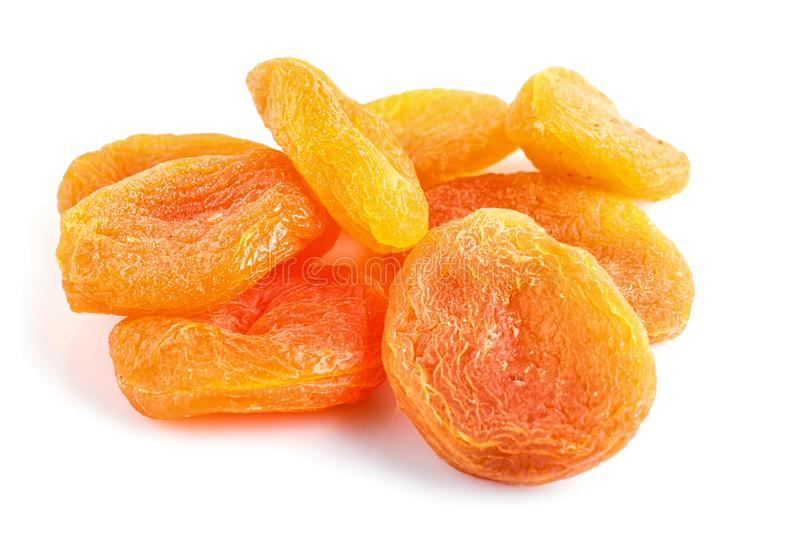 Pile of dried apricots isolated on white background royalty free stock photos