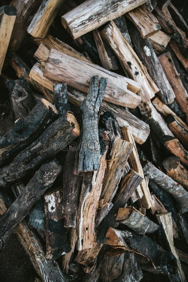 Pile of dried and burnt wood fire logs for fire camp in the Akha village of Maejantai on the hill in Chiangmai, Thailand stock photo