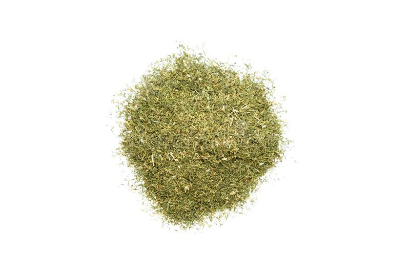 Pile of dried dill. Isolated on white background, top view royalty free stock photo