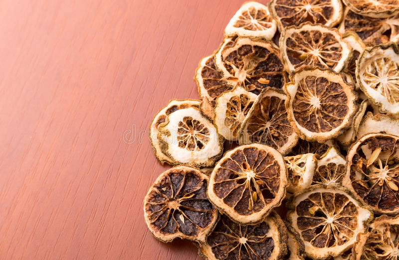Pile of dried lime slices. Heap of dried lime slices closeup royalty free stock image