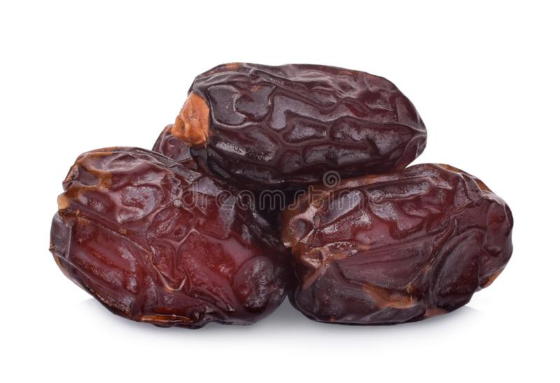 Pile of dried medjool date fruit isolated on white. Background stock photography