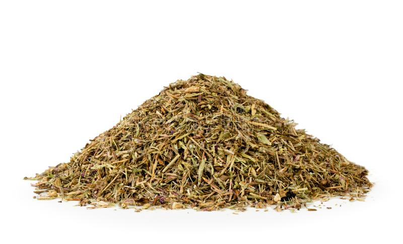 Pile of dried oregano leaves close up on a white background stock photos