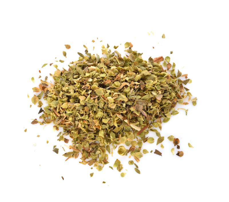 Pile of dried oregano leaves isolated on white background royalty free stock photography