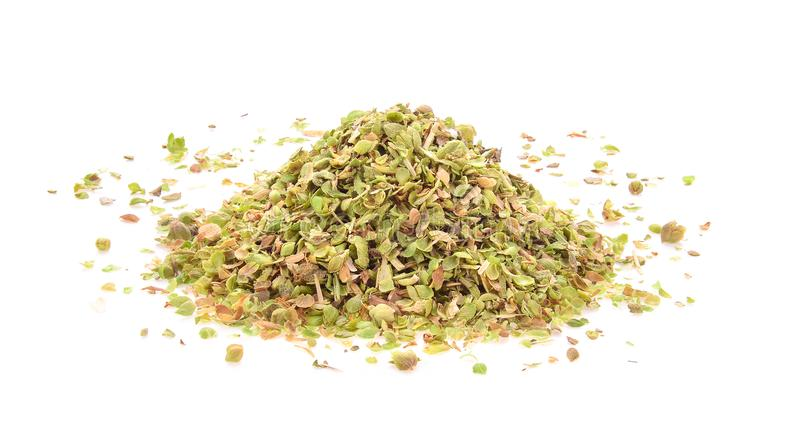 Pile of dried oregano leaves isolated on white background royalty free stock images