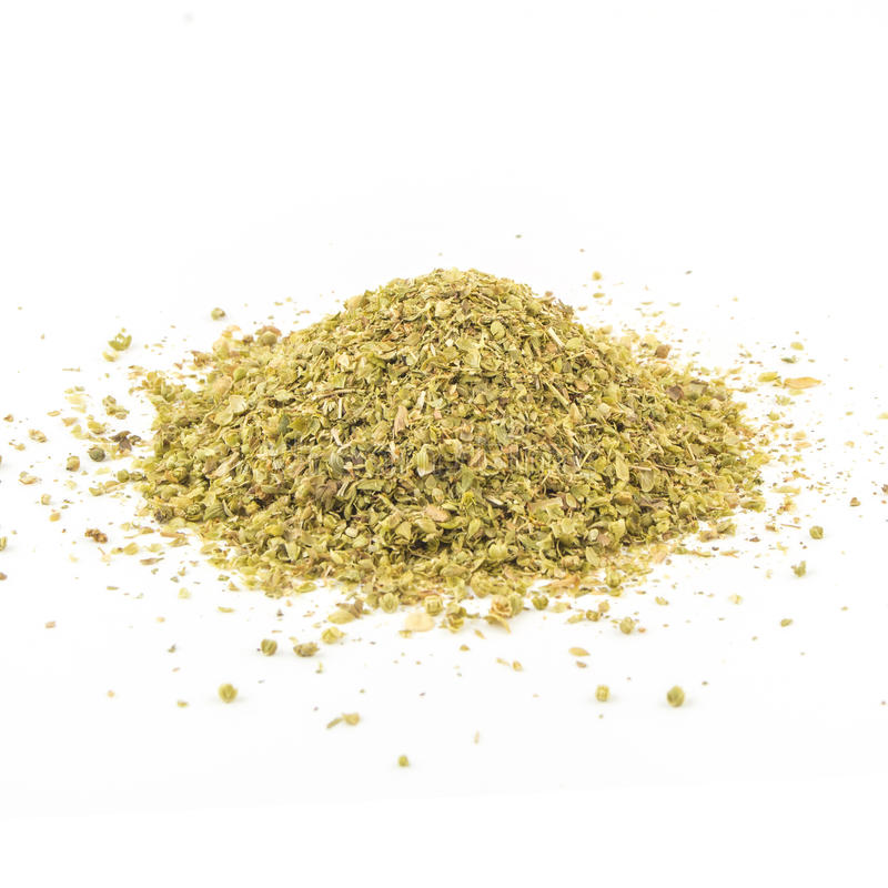Pile of dried oregano leaves on a white background royalty free stock photos