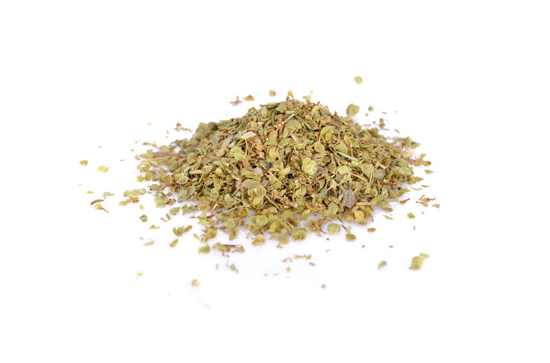 Pile of Dried oregano leaves on white background royalty free stock images