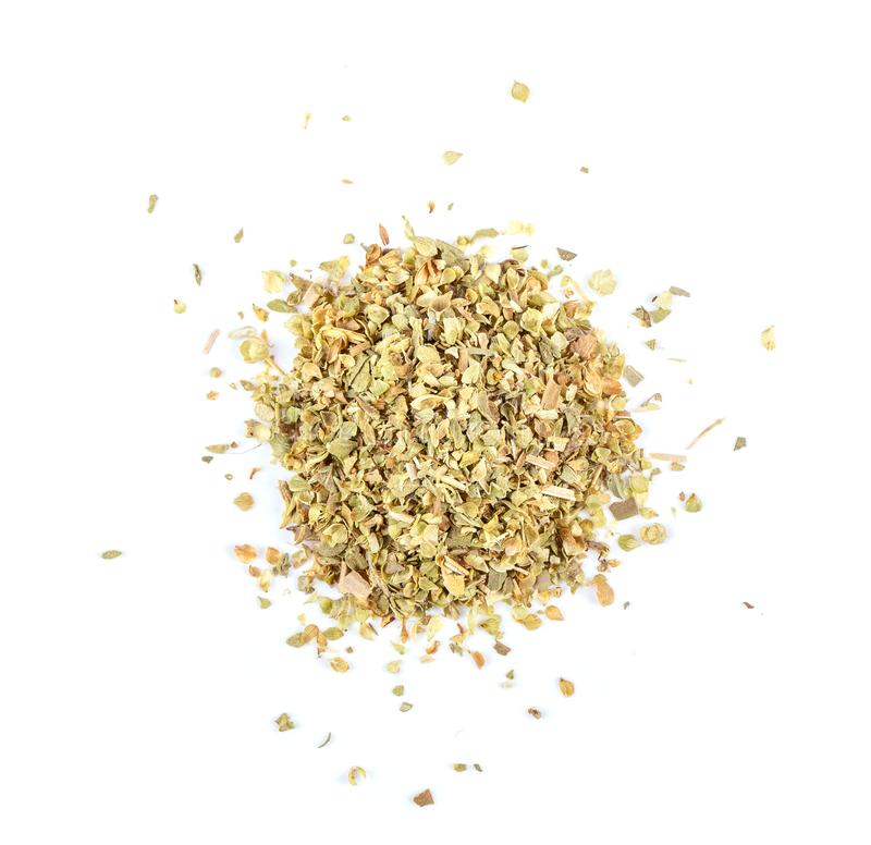 Pile of dried oregano leaves on a white background. royalty free stock images