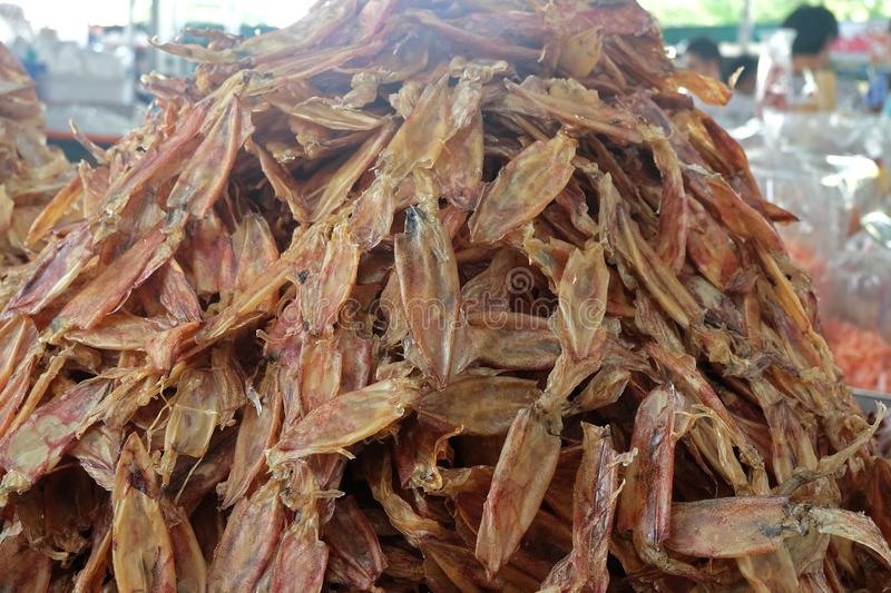 pile of Dried squid Seafood processing for sale at Seafood local Market royalty free stock photo