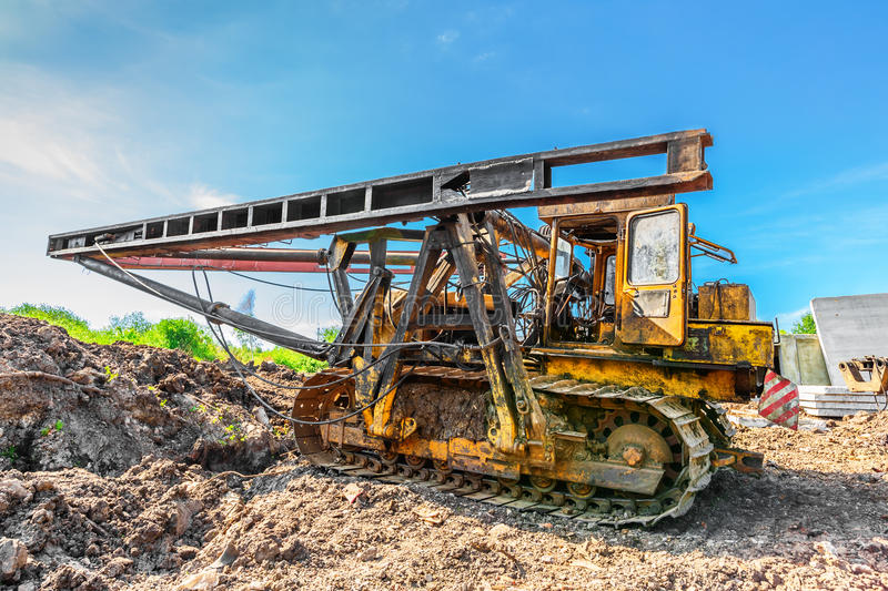 Pile driver. On construction site in summer morning royalty free stock images