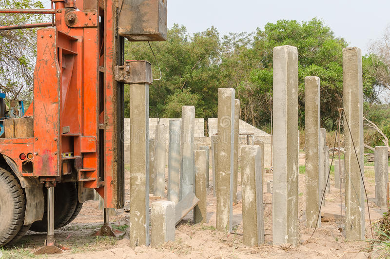 Pile driver driving precast concrete pile. S on a construction site royalty free stock images