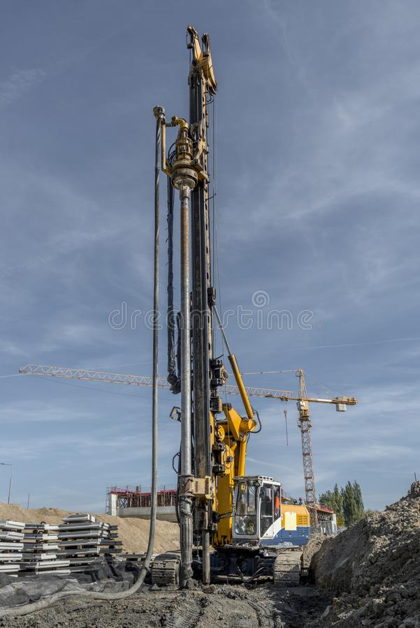 Pile driving drilling machine working on road construction. Road building with drilling machine. Drilling machine ready to drill piles on a road building site royalty free stock images