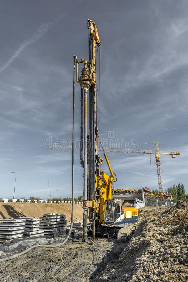 Pile driving drilling machine working on road construction. Road building with drilling machine. Drilling machine ready to drill piles on a road building site royalty free stock photography