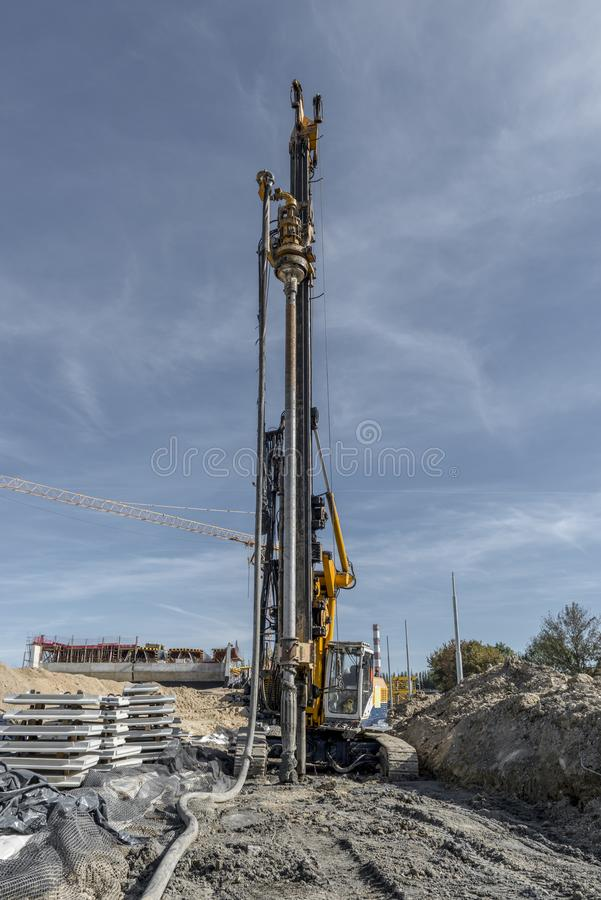 Pile driving drilling machine working on road construction. Road building with drilling machine. Drilling machine ready to drill piles on a road building site royalty free stock image