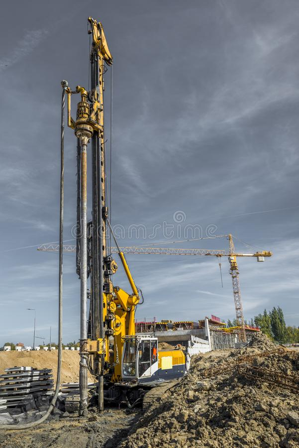 Pile driving drilling machine working on road construction. Road building with drilling machine. Drilling machine ready to drill piles on a road building site stock photo