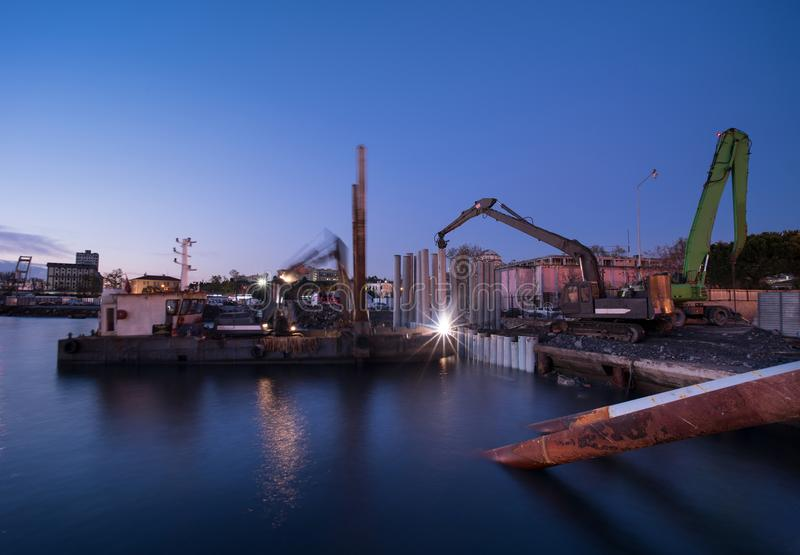 Pile driving machines. Sea filling work stock photos