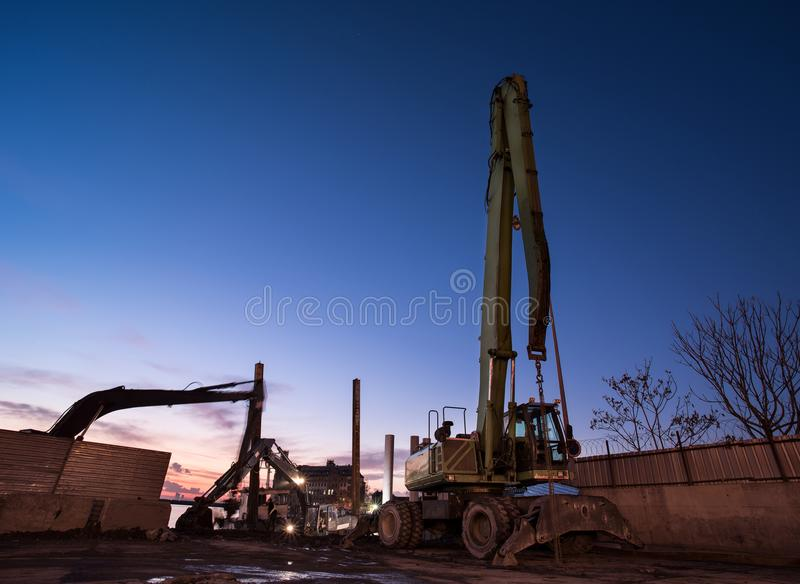 Pile driving machines. Sea filling work royalty free stock photography