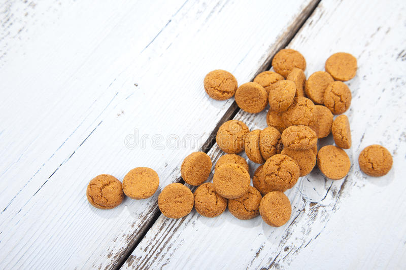 Pile of Dutch candy pepernoot on wooden background royalty free stock images