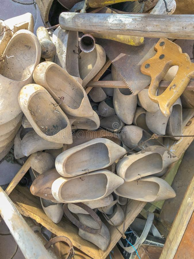 Pile of Dutch wooden clog on a market royalty free stock photos