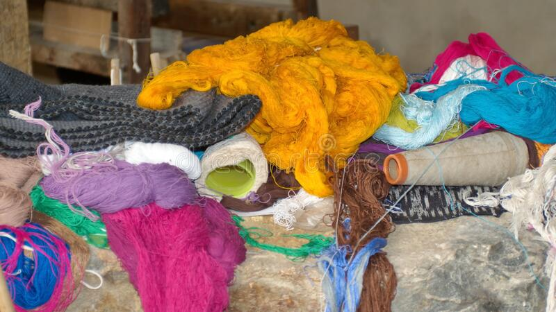 Pile of dyed thread and fabric. At an ikat weaving shop in Gualaceo, outside Cuenca, Ecuador stock image
