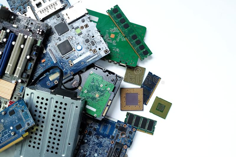 Pile of electronic waste, Motherboard computer and cpu microchips  electronic equipment. Printed Circuit Board on white background, E-waste is a problem with royalty free stock photo
