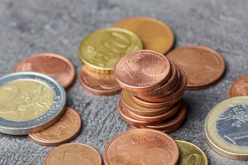 Pile of euro cent coins with one and two euro coin stock photo