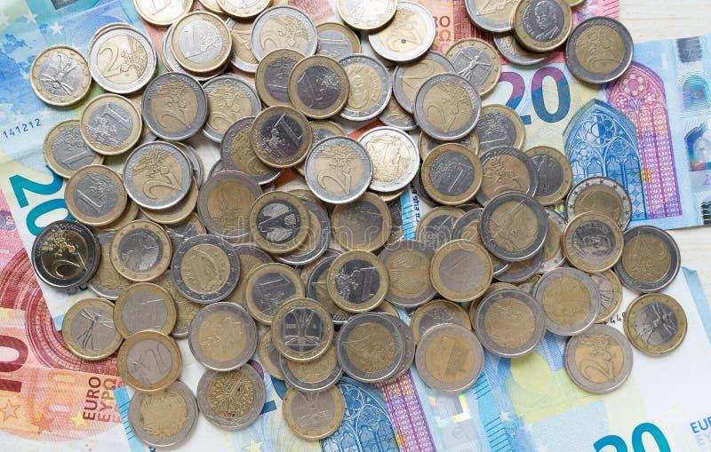 Pile euro coins on banknotes. European money flatlay. royalty free stock photo