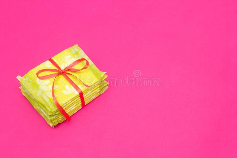 A pile of feminine sanitary pads on a pink background, close-up, copy space, periodicity, gynecology stock image